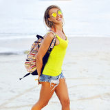 Pretty young woman having fun on a beach in summertime Stock Image
