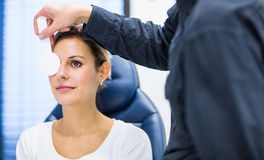 Pretty young woman having her eyes examined Stock Images