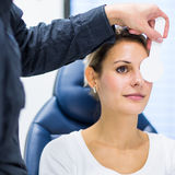 Pretty young woman having her eyes examined Stock Photo