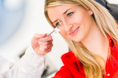 Pretty young woman having her eyes examined Royalty Free Stock Images