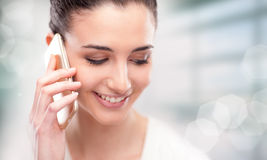 Pretty young woman having a phone call Royalty Free Stock Photos