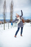 Pretty, young woman having troubles walking on an icy Stock Photos