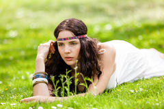 Pretty young woman in a headband daydreaming Stock Photos
