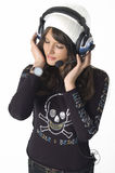 Pretty young woman with headphones. And a cap Stock Photos