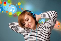 Young woman listening to music with headphones. Pretty young woman with headphones listening to music, bubbles concept Royalty Free Stock Photo