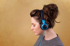 Young woman with headphones listening to music with copy space Royalty Free Stock Photo