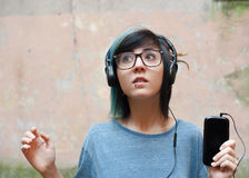 Pretty young woman with headphones and mobile phone Stock Photography