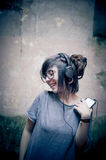 Pretty young woman with headphones and mobile phone Stock Photos