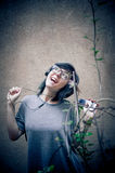 Pretty young woman with headphones and mobile phone Royalty Free Stock Photography