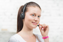 Pretty young woman with a headset Stock Image