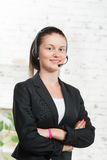 Pretty young woman with a headset Stock Photography