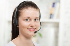Pretty young woman with a headset Stock Photo