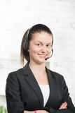Pretty young woman with a headset Royalty Free Stock Photos