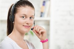 Pretty young woman with a headset Stock Images