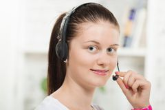 Pretty young woman with a headset Royalty Free Stock Photo