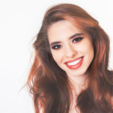 Pretty young woman with healthy perfect hair and white smile Royalty Free Stock Photos