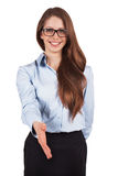 Pretty woman held out her hand in greeting. Pretty young woman held out her hand in greeting Royalty Free Stock Images