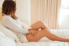 Pretty young woman in her bed Royalty Free Stock Image