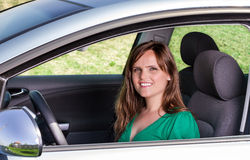 Pretty young woman in her car Stock Photography