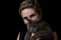 Pretty young woman with her cat Stock Image