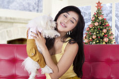 Pretty young woman and her dog at home Stock Photo