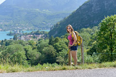 Pretty young woman is hiking in mountains Royalty Free Stock Photos