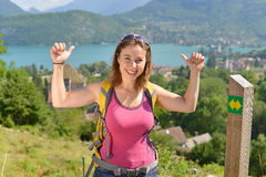 Pretty young woman is hiking in mountains Royalty Free Stock Photography