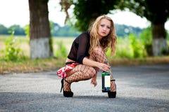 Pretty young woman hitchhiking Stock Photo