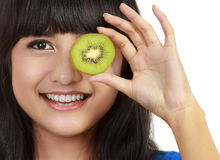 Pretty young woman hold kiwi Stock Photos
