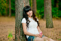 Pretty young woman holdiing mobile phone and smile royalty free stock photo
