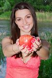 Pretty Young  Woman Holding Apple Royalty Free Stock Photos