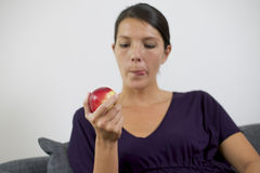 Pretty young woman holding an apple Stock Photography
