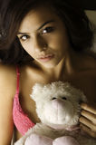 Pretty young woman holding bear. Royalty Free Stock Photo