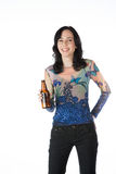 Pretty young woman holding a beer bottle Stock Image