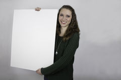 Pretty young woman holding blank sign Royalty Free Stock Photos