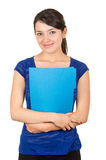 Pretty young woman holding a blue folder. Pretty young happy woman holding a blue folder looking to the camera isolated on white royalty free stock photo