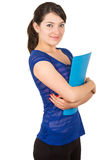 Pretty young woman holding a blue folder. Pretty young smiling woman holding a blue folder crossing arms isolated on white royalty free stock images