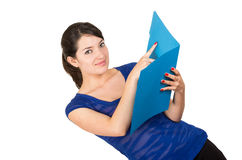 Pretty young woman holding a blue folder. Pretty young smiling woman holding an open blue folder isolated on white stock photography