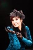 Pretty young woman holding Christmas ball Stock Image