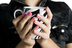 Pretty young woman holding a coffee cup Royalty Free Stock Photos