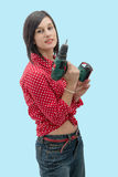 Pretty young woman holding  cordless drill Royalty Free Stock Photo