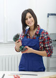 Pretty young woman holding  cordless drill Stock Photography