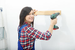 Pretty young woman holding  cordless drill Royalty Free Stock Image