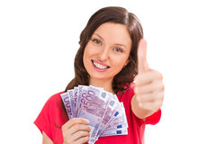 A pretty young woman holding euro and thumbs up Royalty Free Stock Images