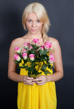 Pretty Young Woman Holding Flowers Royalty Free Stock Image