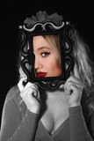 Pretty young woman holding a frame in front of her face Royalty Free Stock Images