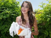 Pretty young woman holding fresh apricots Royalty Free Stock Image