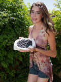 Pretty young woman holding fresh blueberries Stock Images
