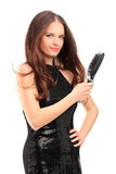Pretty young woman holding a hair brush Stock Images