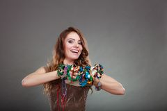 Pretty woman with jewelry necklaces beads and hat royalty free stock image